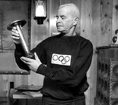 Julius examines the Olympic torch he once carried for the 1936 Olympics in Berlin, Germany.